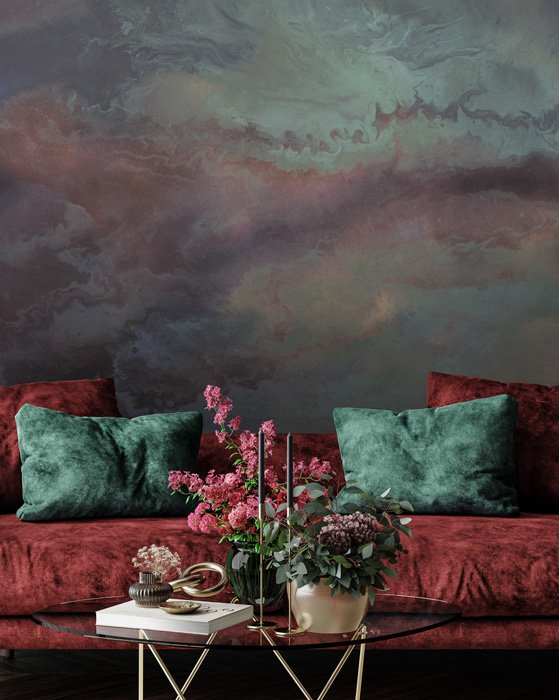 abstract patinated wall mural with red sofa