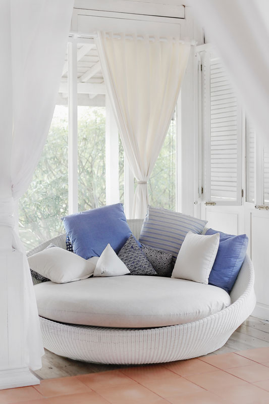 white curtains with a love seat