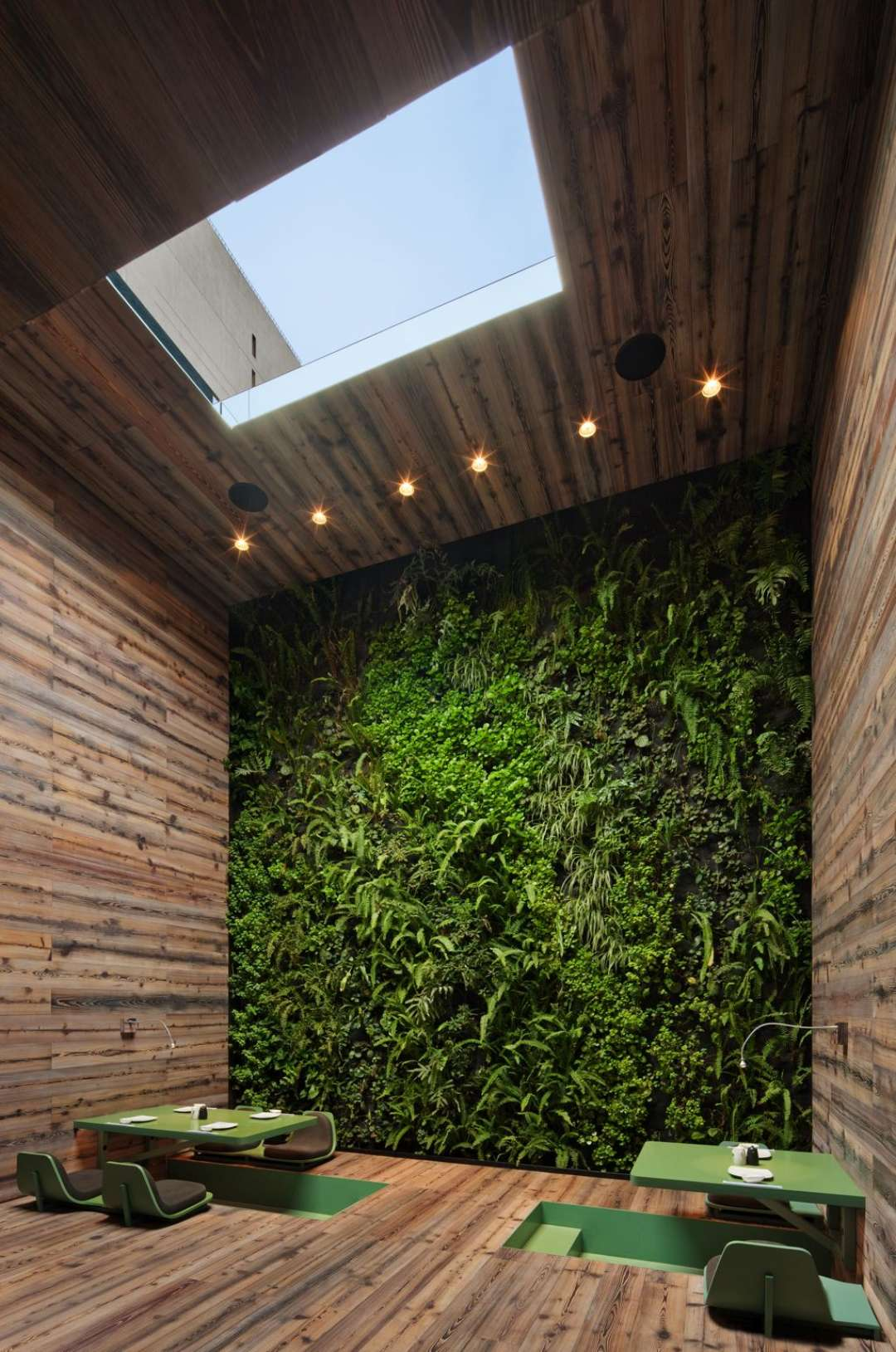 Outside The Steel Structure Emerges From Ground Like Climbing Ivy Whilst Inside There Are Stunning Green Living Feature Walls